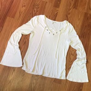 White flared sleeve top with cross ties on chest